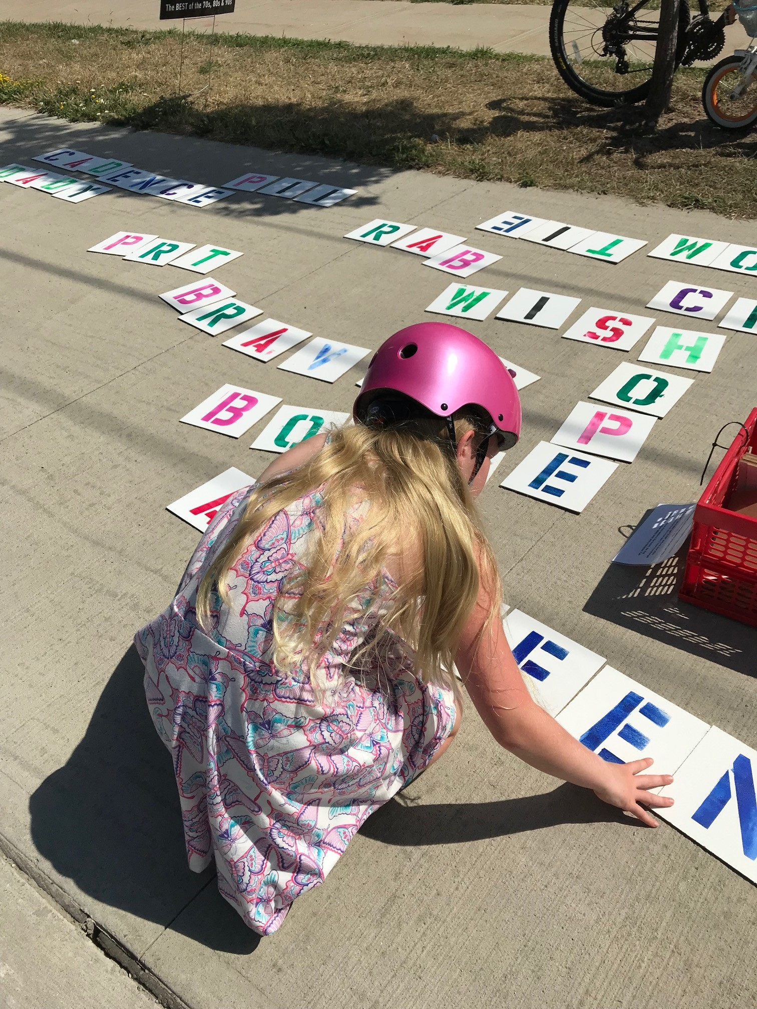 Young girl making words from giant letters at Side Launch Days Harbour Festival