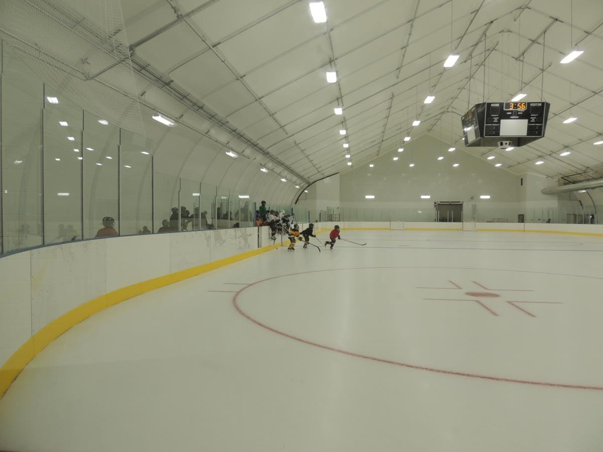Hockey players hitting the ice