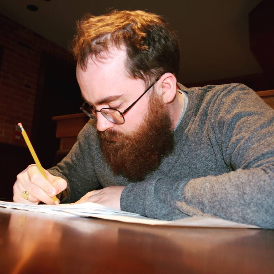 Drew Murdoch at his writing table