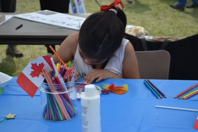 Child drawing at the arts and crafts tent