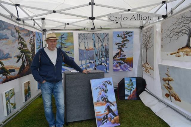Carlo Allion and his artwork at the 2017 Arts and Music Festival