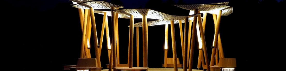 Awen' Gathering Place illuminated in the evening