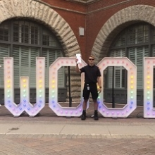 By-law Officers standing beside CWOOD sign
